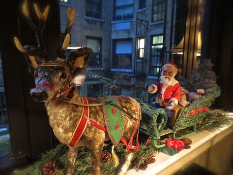 fao christmas orniment a german made 1920 s santa in sleigh with reindeer made for fao schwarz on the windowsill in the