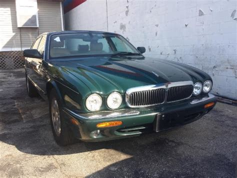 service manual 2000 jaguar xj series how to release spare tyre ford cargo coolant sensor