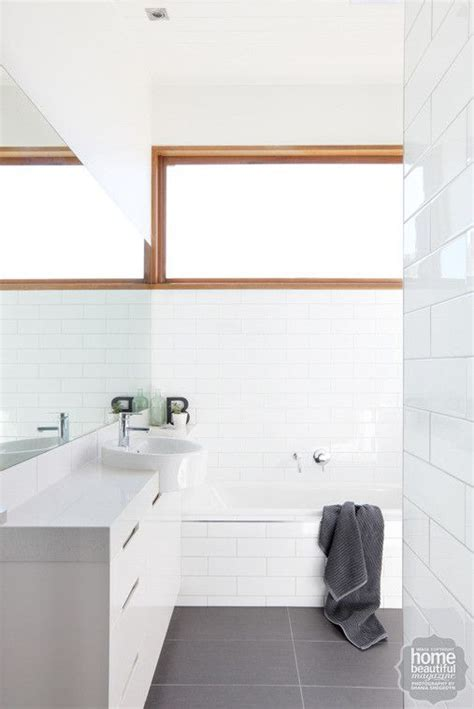In the bathroom, a light and bright scheme is underpinned