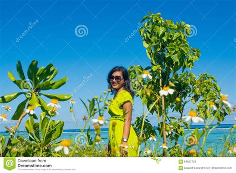beautiful woman by the tree looking up stock photo image portrait of young beautiful asian girl sitting on the