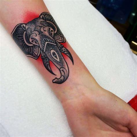 polynesian elephant tattoo black and grey elephant on forearm