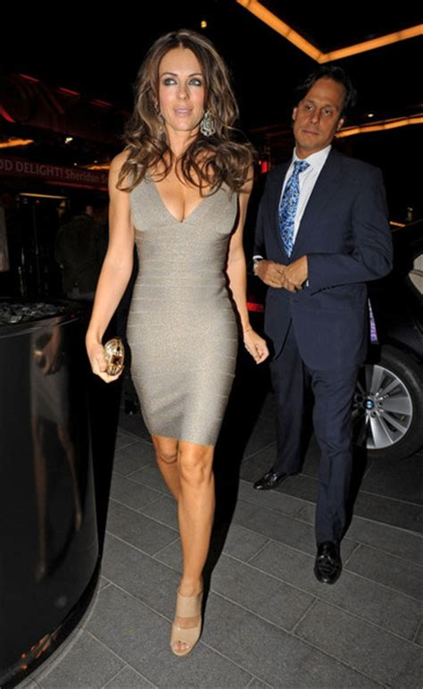 Rn Dress Tania Fit L elizabeth hurley wears a shimmery cocktail dress