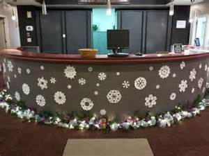 Small Desk Christmas Decorations Front Desk With Snow Flakes And Garland Deangelo