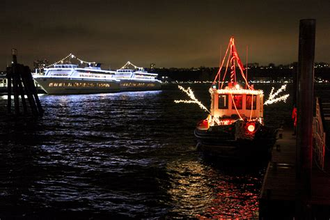 tug boat lights circle line world yacht celebrate the holidays with the