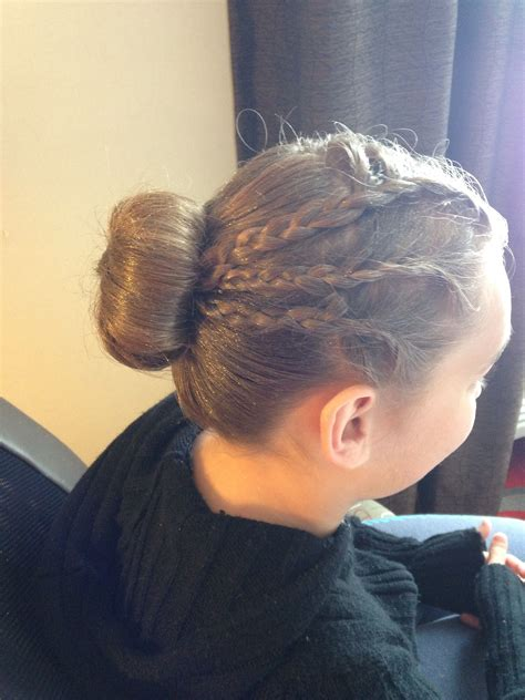 straight black hair pulled back in bun six one sided french braid pulled back into a bun this