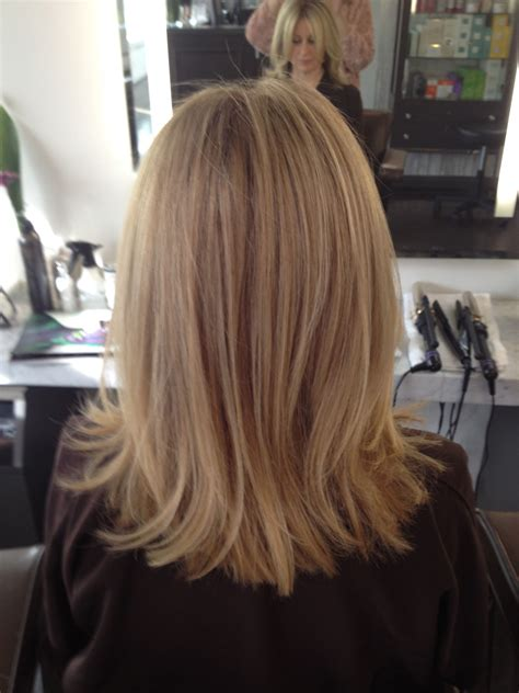 blonde hair with feathered low lights on ends balayage before and after cool blonde chic cut neil george
