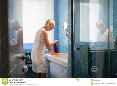 ladies using the bathroom retired woman doing chores and cleaning bathroom royalty