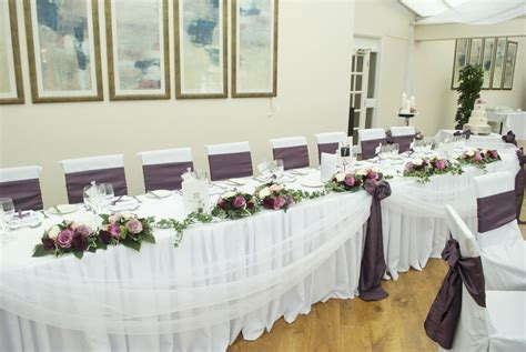 table top decorations mere court wedding flowers dusky lilac pink and