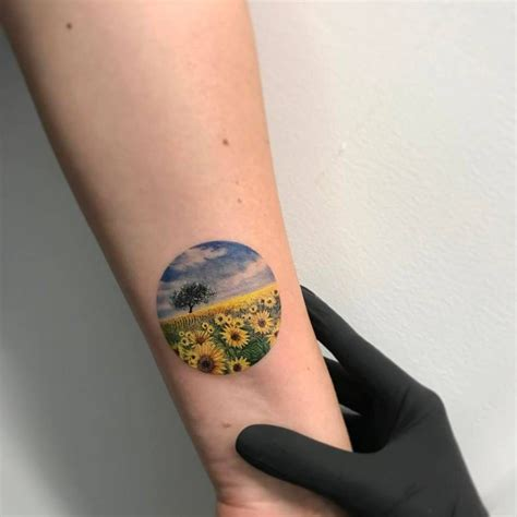 round tattoos sunflower field circle on the left inner forearm