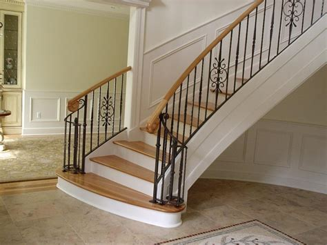 Metal Pickets For Stairs Curved Stairs Metal Pickets Gallery Roes Stair Company