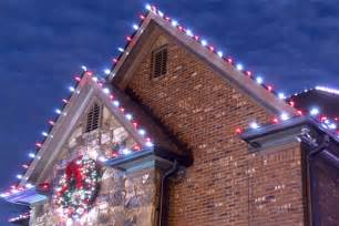 hanging lights on house how to hang lights on gutters