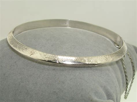 vintage 1960 70 s sterling silver etched hinged bangle