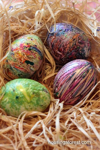 dying easter eggs creatively s melted crayon easter eggs housing a forest