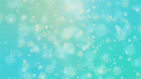 beautiful teal blue glowing bokeh background with floating