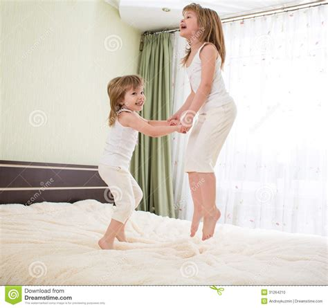 jumping on bed stock photo image 31264210