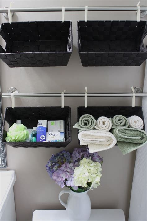 bathroom storage with baskets simply diy 2 a tisket a tasket a wall of baskets