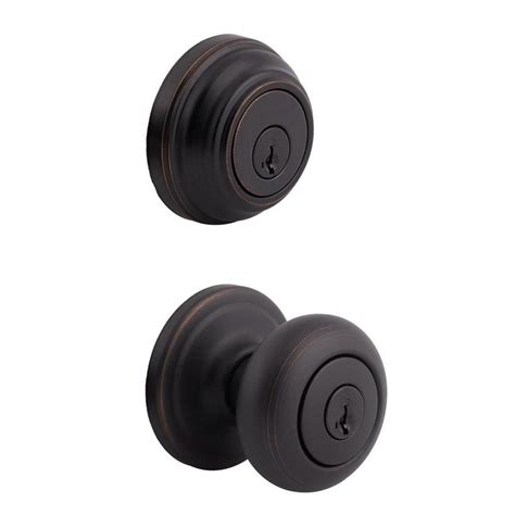 Kwikset Rubbed Bronze Door Knobs by Shop Kwikset Juno Venetian Bronze Single Cylinder Deadbolt