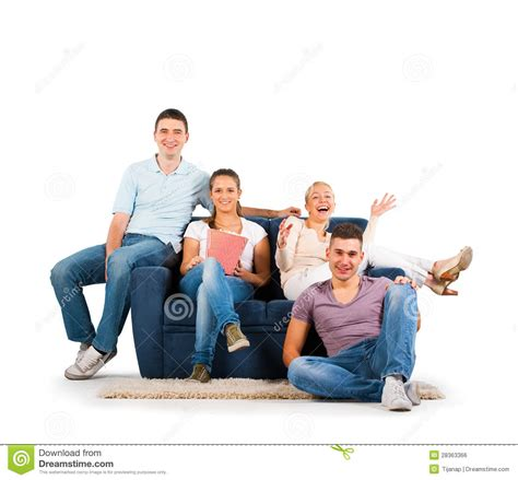 people sitting on a couch young people sitting on a sofa smiling royalty free stock