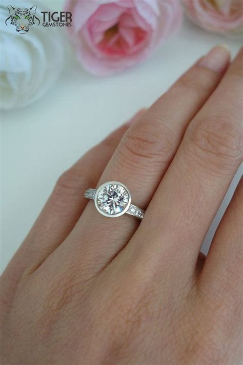 1.5 Carat Bezel Set Round Cut Accented by TigerGemstones