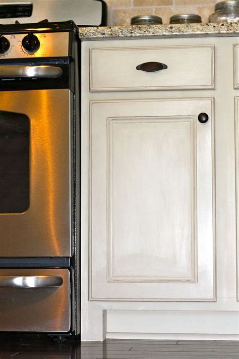 off white kitchen cabinets with stainless steel appliances chalk painted kitchen cabinets painted kitchen cabinets