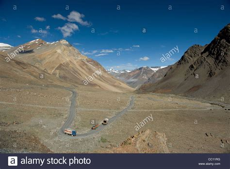 rugged valley trucks passing through a rugged valley on the leh manali highway stock photo royalty free image