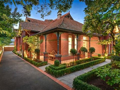 Brickhouse Cottages by Brick House With Brick Lining Asphalt Driveway Home