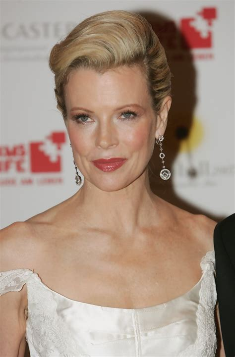 updo hairstyles for women over 50 kim basinger s updo haute hairstyles for women over 50