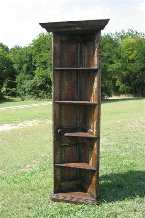 Cool Homemade Bookshelves - turn an old door into a corner shelf diy projects for everyone