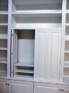 pocket doors in kitchen cabinetry perfect for hiding a tv pocket doors doors and door hinges on pinterest