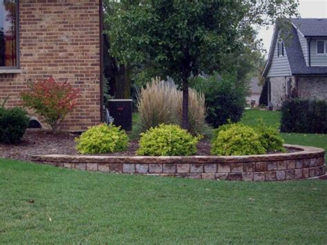landscaping bi level home retaining wall on corner of