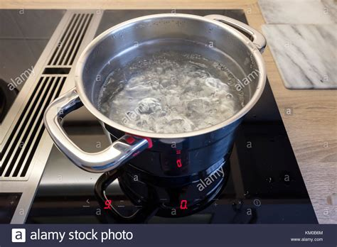 induction cooking boiling water stove extractor fan stock photos stove extractor fan stock images alamy