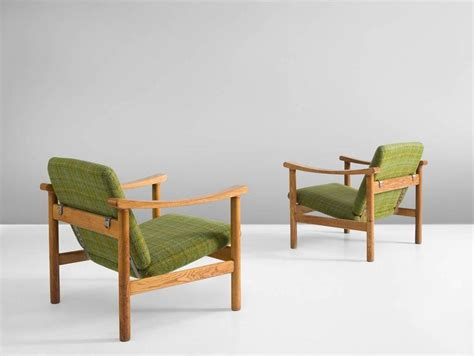 armchairs checked fabric hans wegner armchairs in green checked fabric and oak for