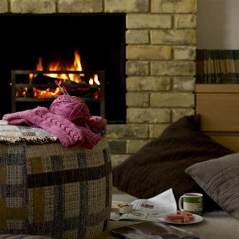 how to make a room feel warmer cosy living room fireplaces pouffe housetohome co uk