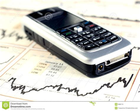 mobile stock charts mobilephone on stock chart royalty free stock photo