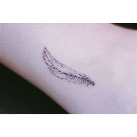 simple feather tattoo designs best 25 feather wrist ideas on feather