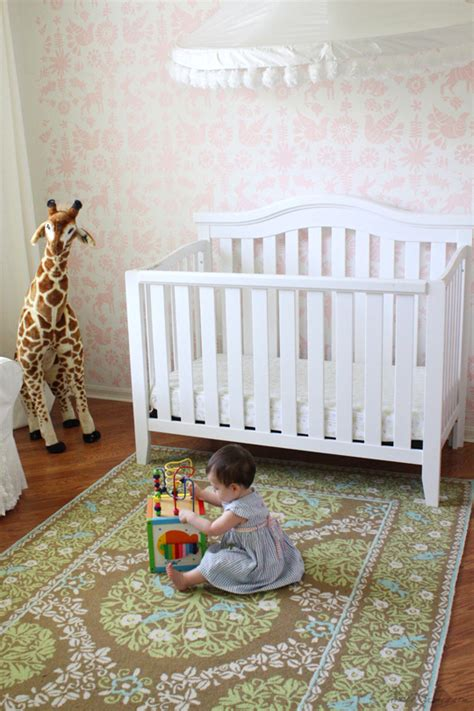pink and brown nursery rug stenciled nursery with pom pom canopy house mix