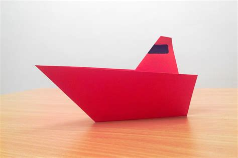 How To Make A Ship Out Of Paper - how to make an origami boat step by step