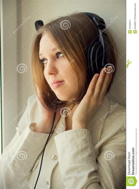 beautiful house music beautiful girl listen music near the window stock photo image 49166011