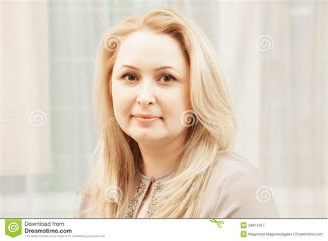 this pretty blond haired middle aged stock photo 86043952 serene middle aged blonde stock image image of female