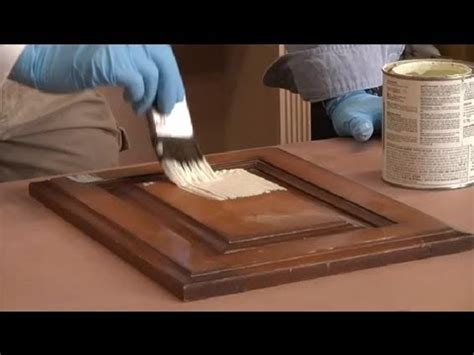 painting stained woodwork steps in painting kitchen cabinets that are stained