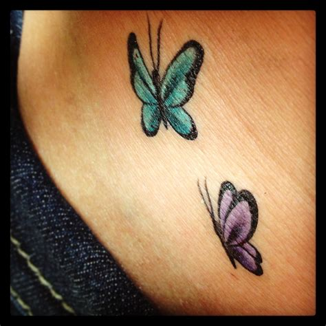 small butterfly tattoo on hip tattoo pinterest