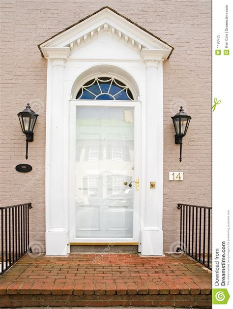 At The House Door by Georgian Front Door Of Brick House Royalty Free Stock
