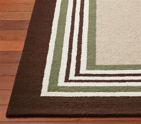 green and brown striped rug tailored striped rug pottery barn