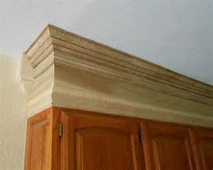 add crown molding to fill in those blank spaces above the kitchen cabinet cornice details let s face the music