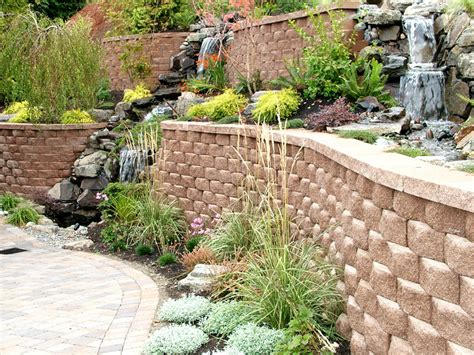 Retaining Wall Planter by Retaining Wall With Waterfall Into Planter Landscaping