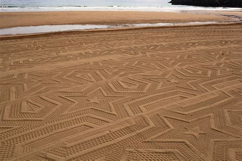 sand pattern artist tractor creates amazing sand art on the beach bored panda