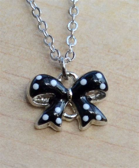 A Polka Dot Ribbon Necklace Inspired By Louis Vuitton Adds Chic To Any Ensemble Fashiontribes Fashion by White Polka Dots On Black Ribbon Necklace On Luulla