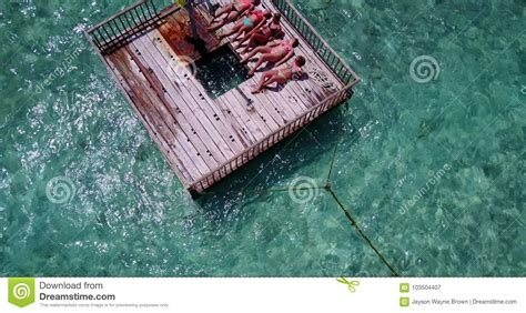drone with pontoons v09178 group of young beautiful girls sunbathing on