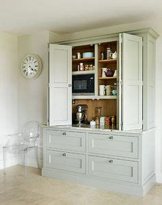 pocket doors in kitchen cabinetry perfect for hiding a tv recycle bifold doors doors appliance lift double wide