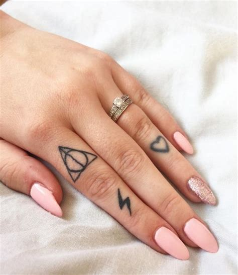 small cute finger tattoos here for deathly hallows and hearts deathly hallows